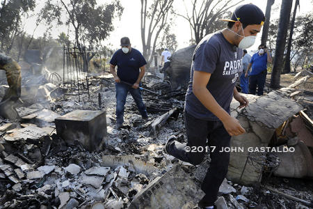 December 8, 2017 The Diaz Family cleans up their property in Bonsall, CA. after the Lilac Fire.  The family home helped raise nine siblings.