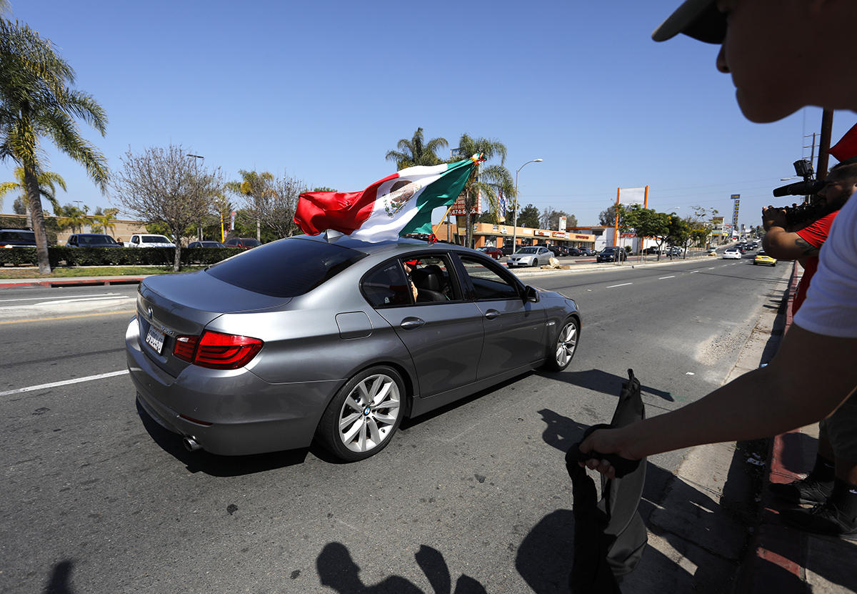 National City Mexican-Americans celebrate as Mexico advances in World Cup soccer.  : On Assignment : San Diego Corporate and Event Photographer